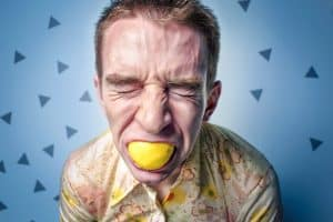 man with lemon in his mouth