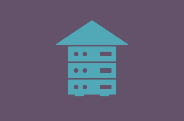 A house made up of blue servers and a blue roof on top