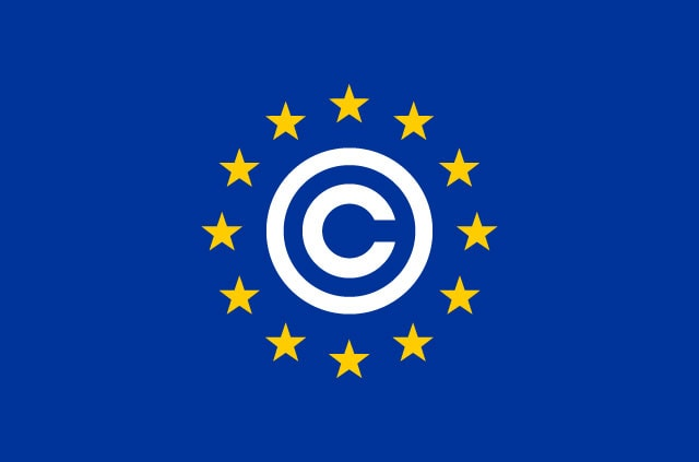 A copyright symbol surrounded by yellow stars on a blue background