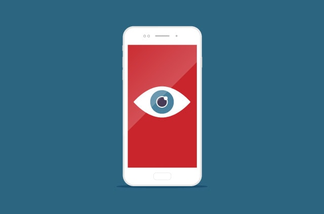 A smartphone screen with an open eye on a red background.