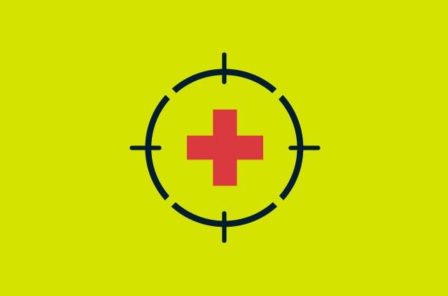 Health cross symbol inside cross hairs.
