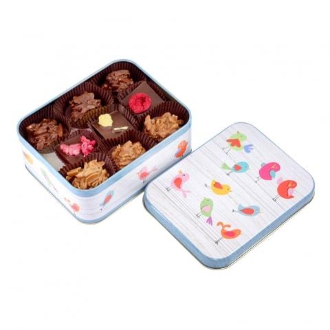 puszki z czekoladkami ostrów