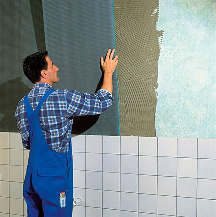 Процесс выравнивания стен гипсокартоном