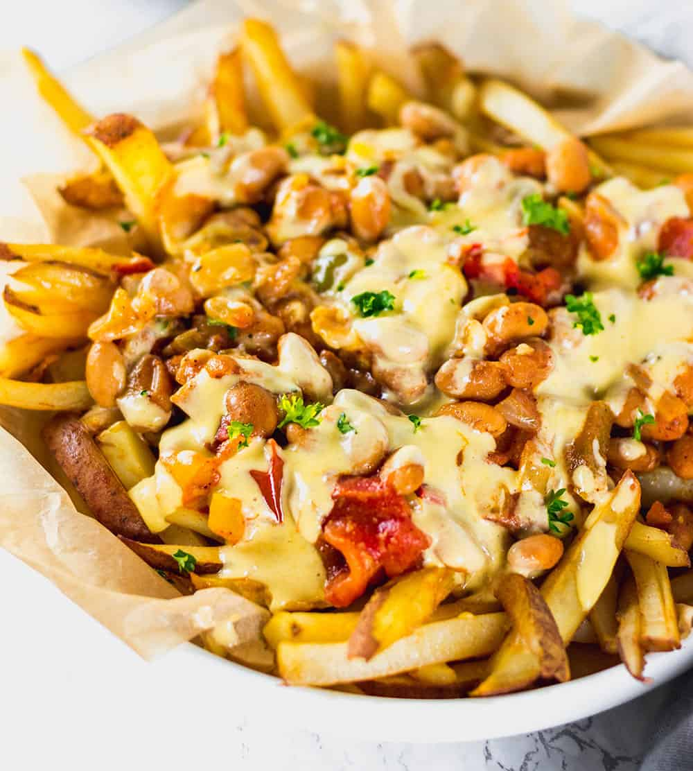 chili cheese fries in a white bowl