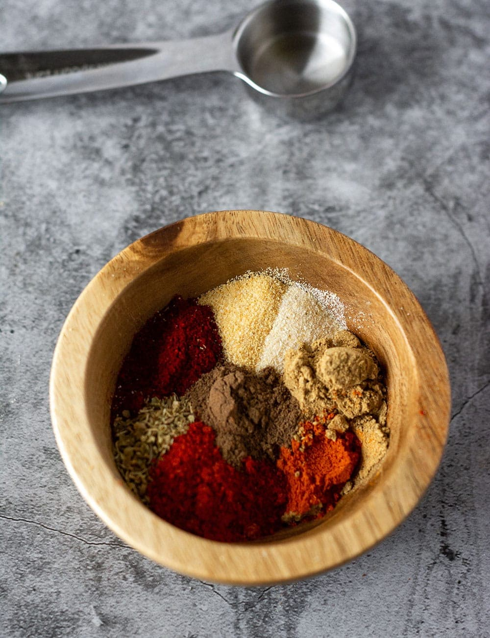 chili powder in wooden bowl