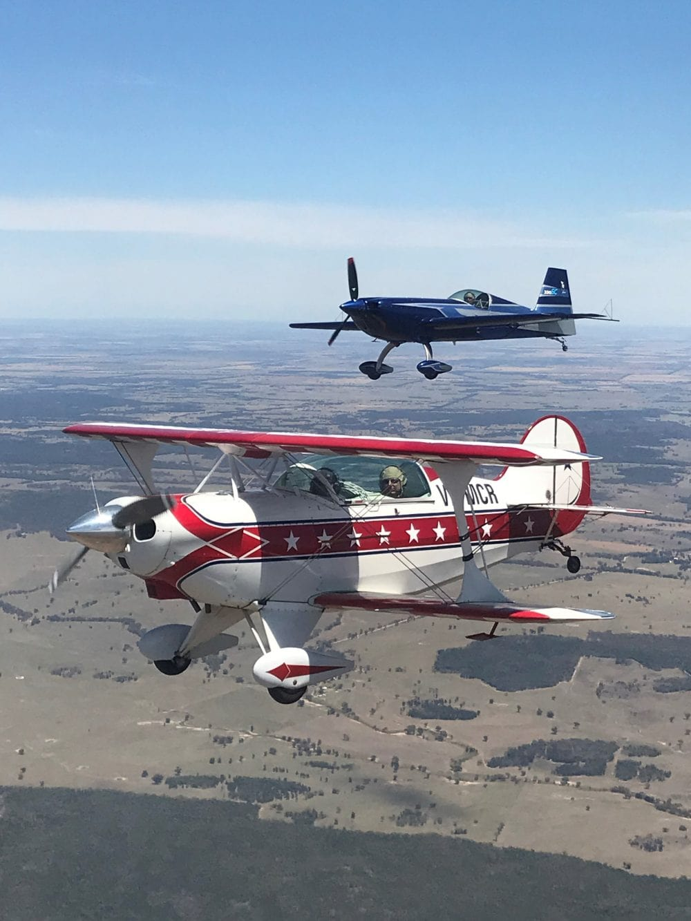 AAA Pitts Special and Extra aerobatic aircraft in formation
