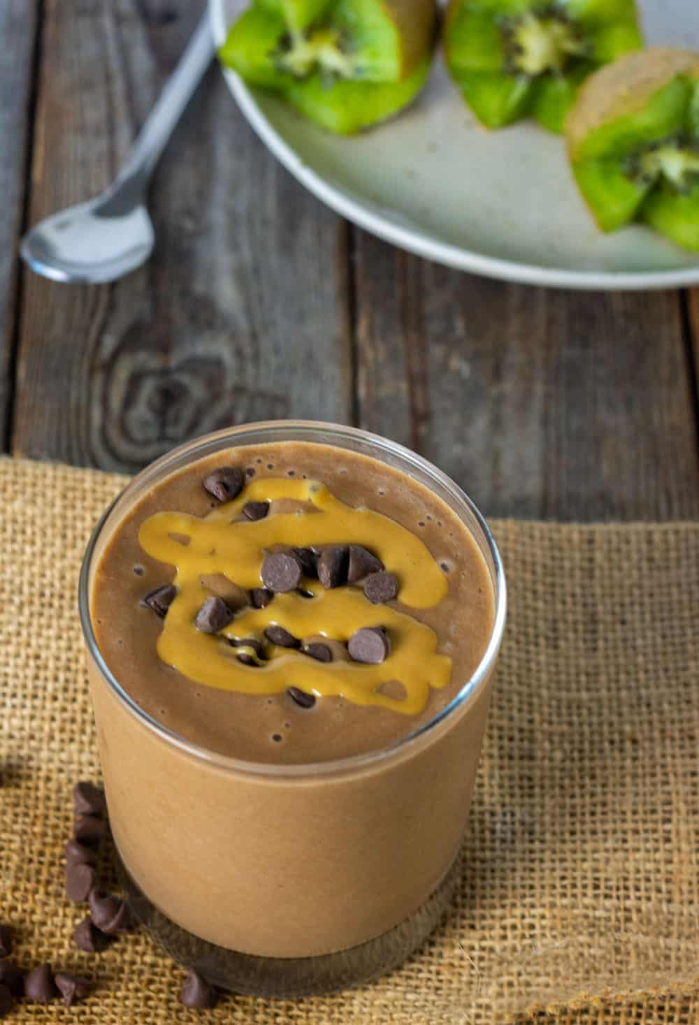 Overlay of Maca Peanut Butter Smoothie, easy recipe garnished with carob chips and peanut butter
