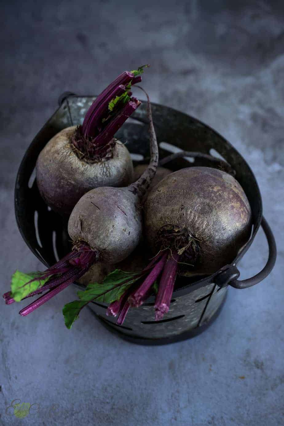 Raw beets in a metal basket