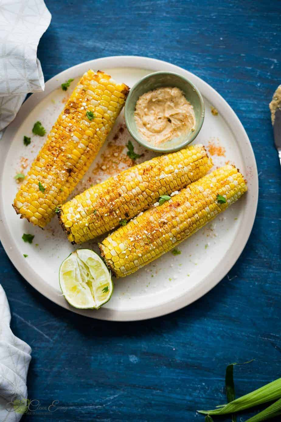 roasted corn on the cob served with chili lime butter, lime wedges, sprinkle with goat cheese, paprika and fresh cilantro.