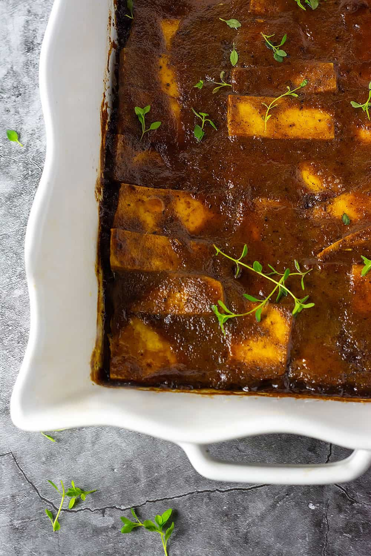 a casserole dish with jerk tofu