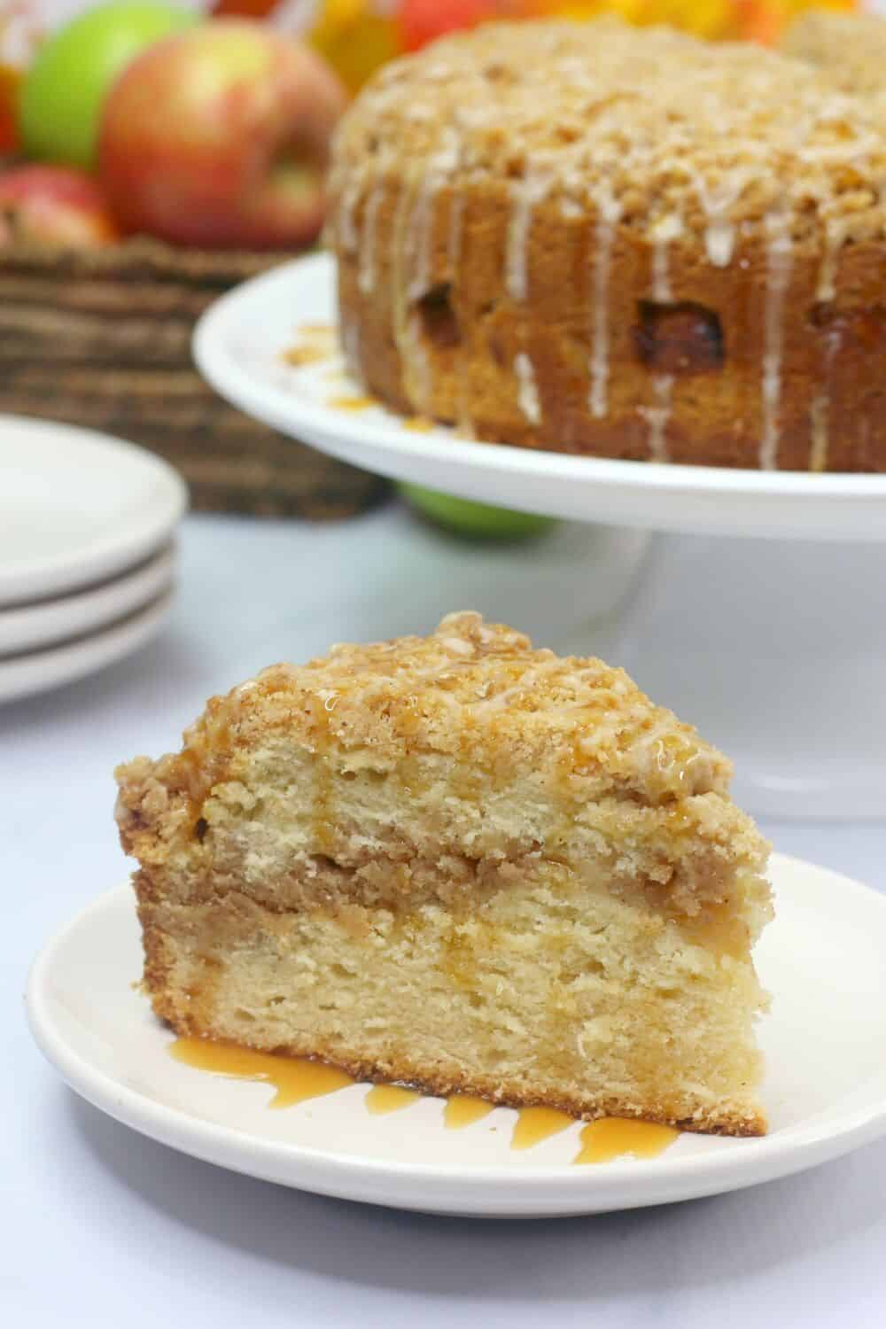 Salted Caramel Apple Cake is moist, fluffy and loaded with fresh sweet apples. It is then drizzled with a decadent salted caramel glaze. This apple cake recipe is a winner! #applecake #applecrumbcake #saltedcaramel #appledessert