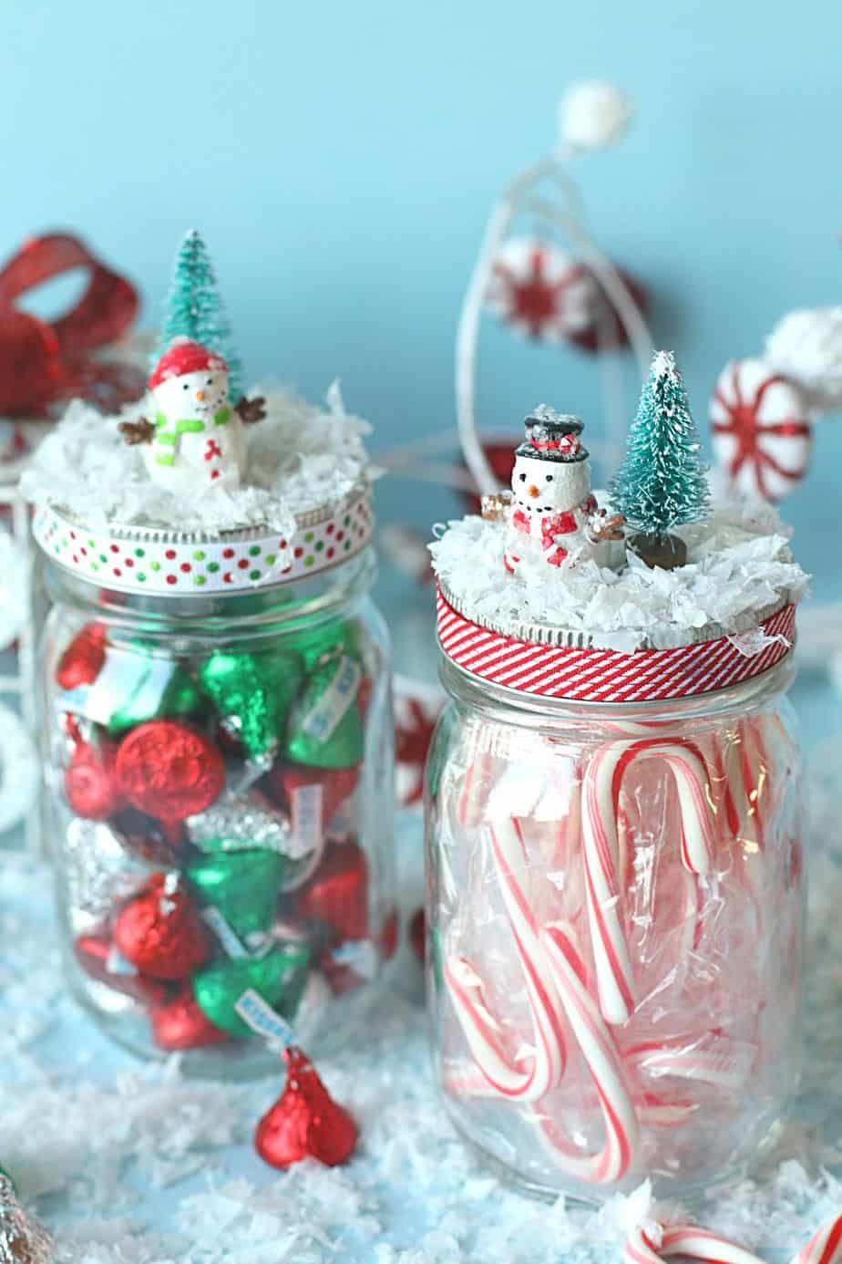 Spread some sweet cheer to friends and family with these DIY Christmas Mason Jar Gifts. Fill these treat jars with Christmas candy or a favorite snack. Mason jar gifts are easy to make and fun to give. #masonjarcraft #christmasgift #christmasmasonjargift