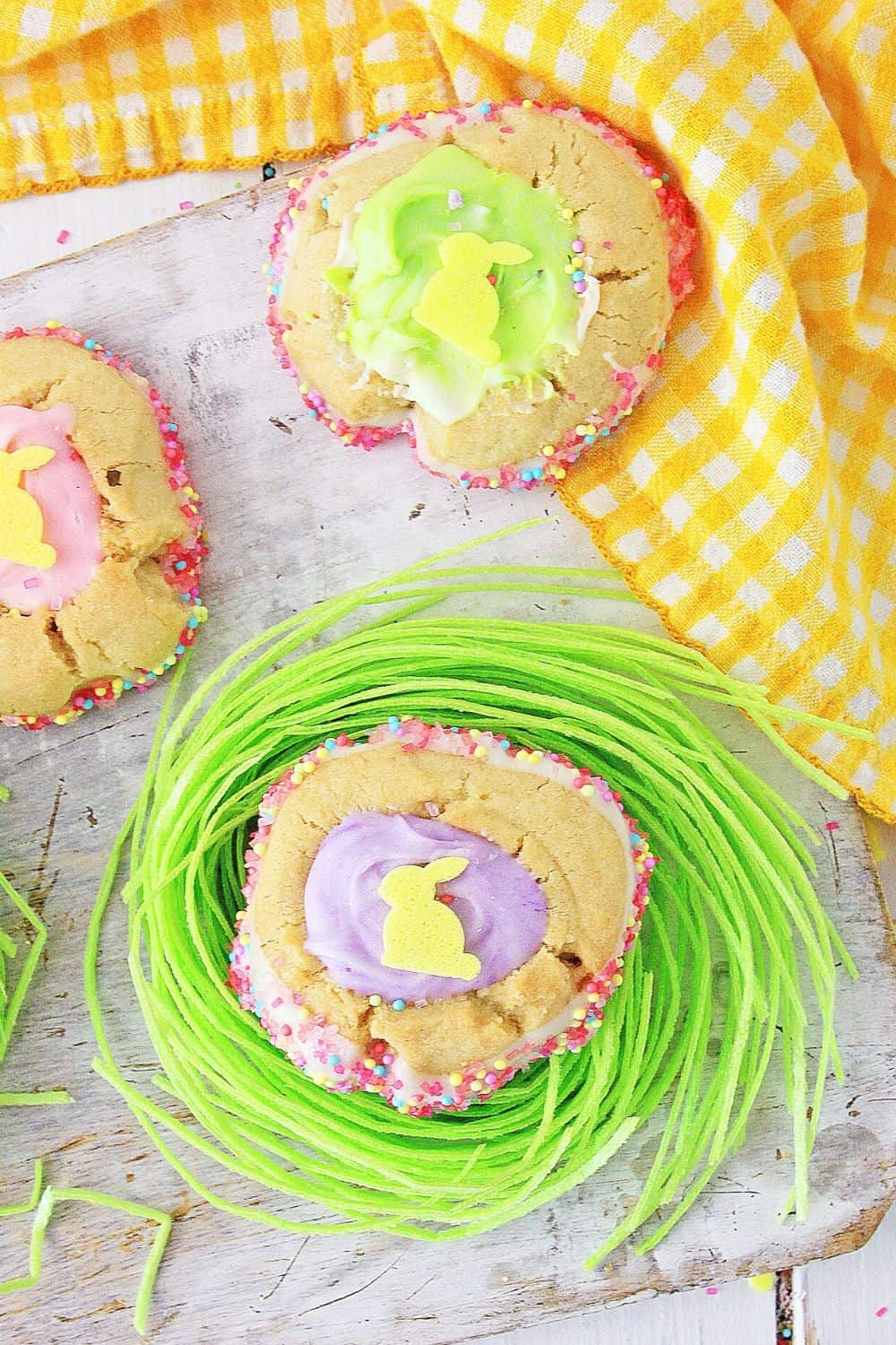 These homemade Easter Thumbprint Cookies are a sure sign of spring. Bake a batch of these easy colorful holiday cookies to share today. Everyone love thumbprint cookies!