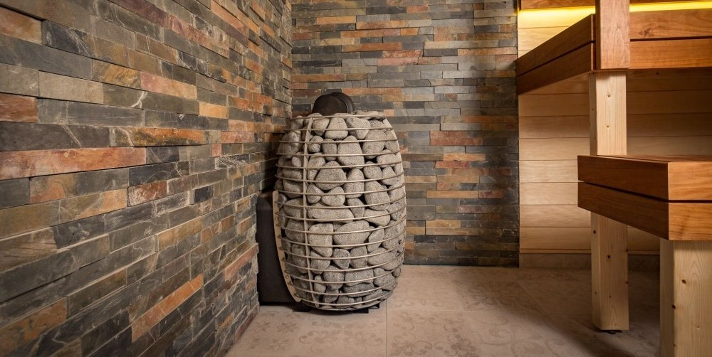 a basket full of sauna rocks - this is the feature image of best sauna heater review article