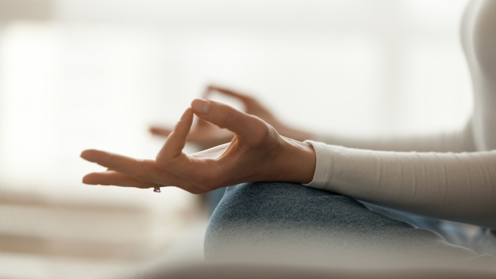 Close,Up,Peaceful,Woman,Sitting,In,Lotus,Pose,And,Meditating,
