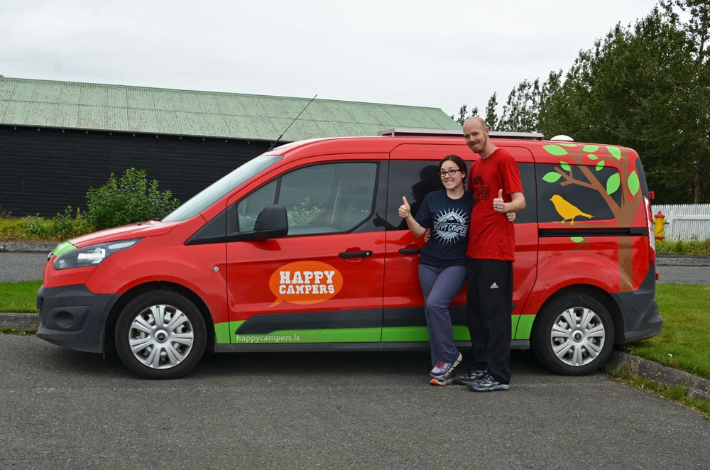 Brooke and Buddy posing outside their Happy Campers Van in Iceland