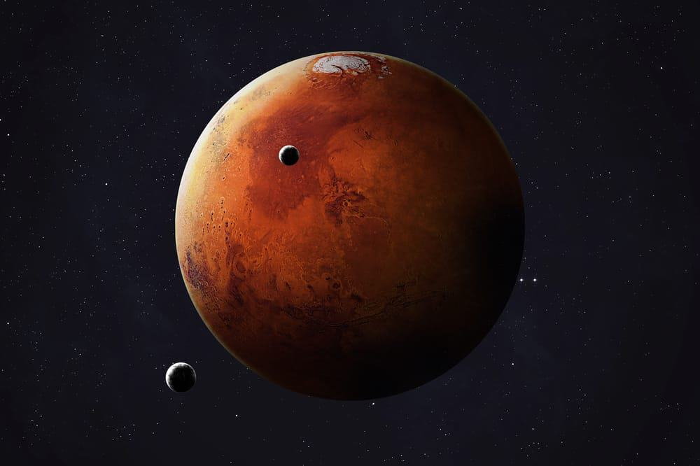 Mars and its moons collage photo of Mars through Hubble telescope camera captures