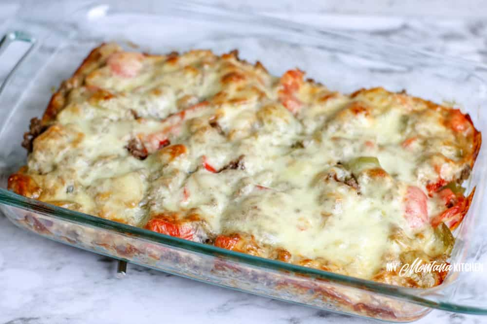 baked philly cheesesteak casserole with melted cheese