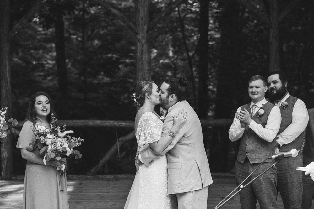 bride and groom kissing at the end of the ceremony