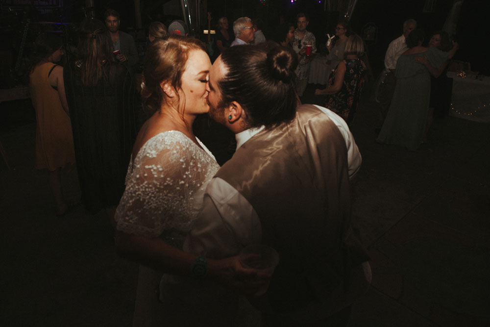 bride and groom kissing at wedding reception, terrapin hill farm