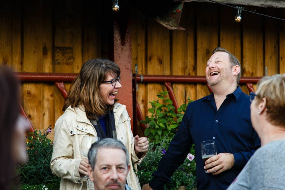 two people laughing at an event at park house barn