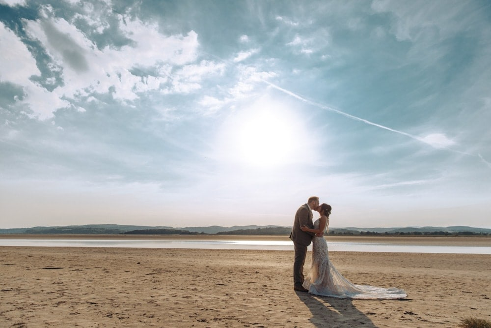 Bride and groom portraits on the beach in the lake district