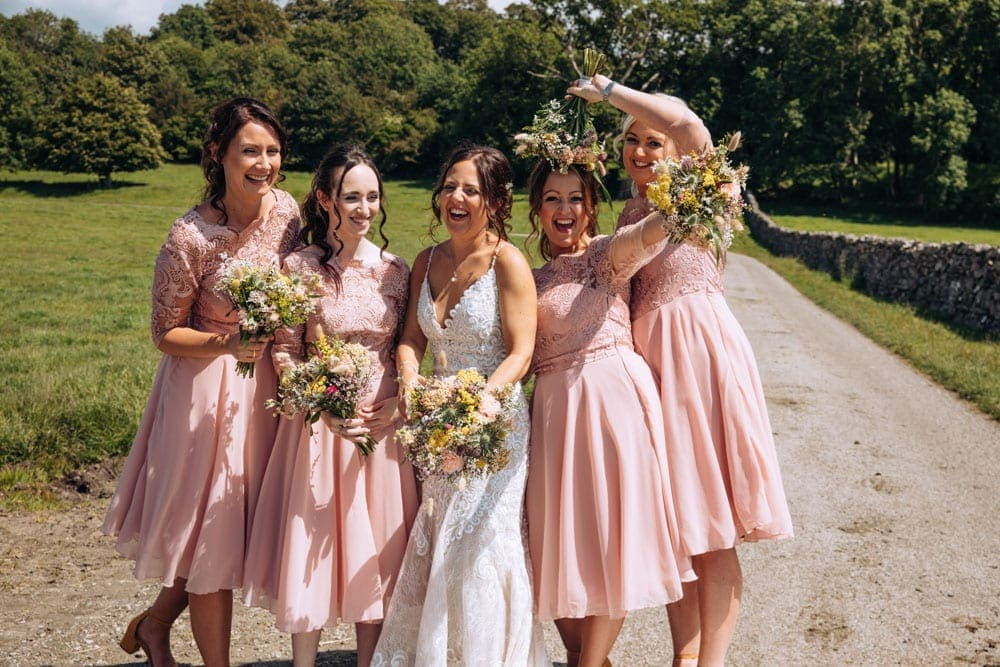 group wedding photos of bride and groom and wedding guests at park house farm