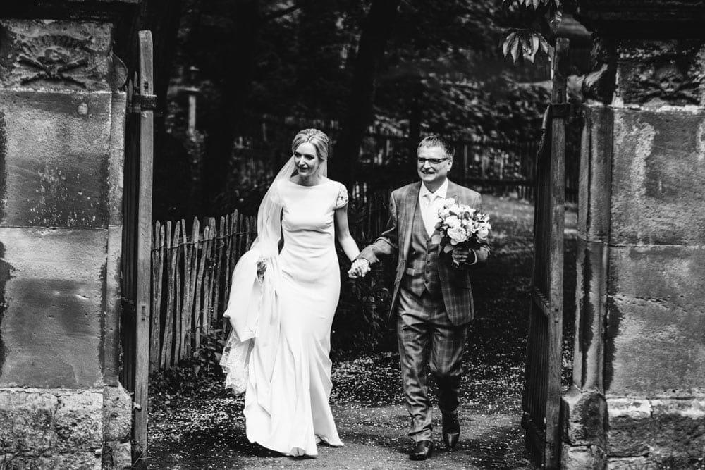 bride walking down the aisle in a cheshire church