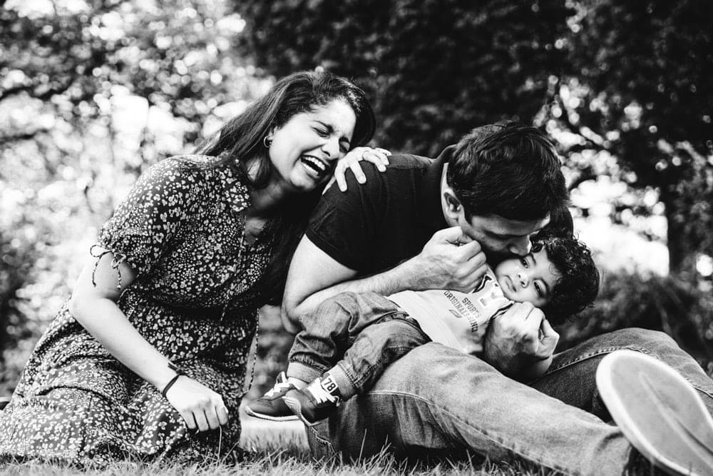 family having a giggle at their family photoshoot in hyde park stockport