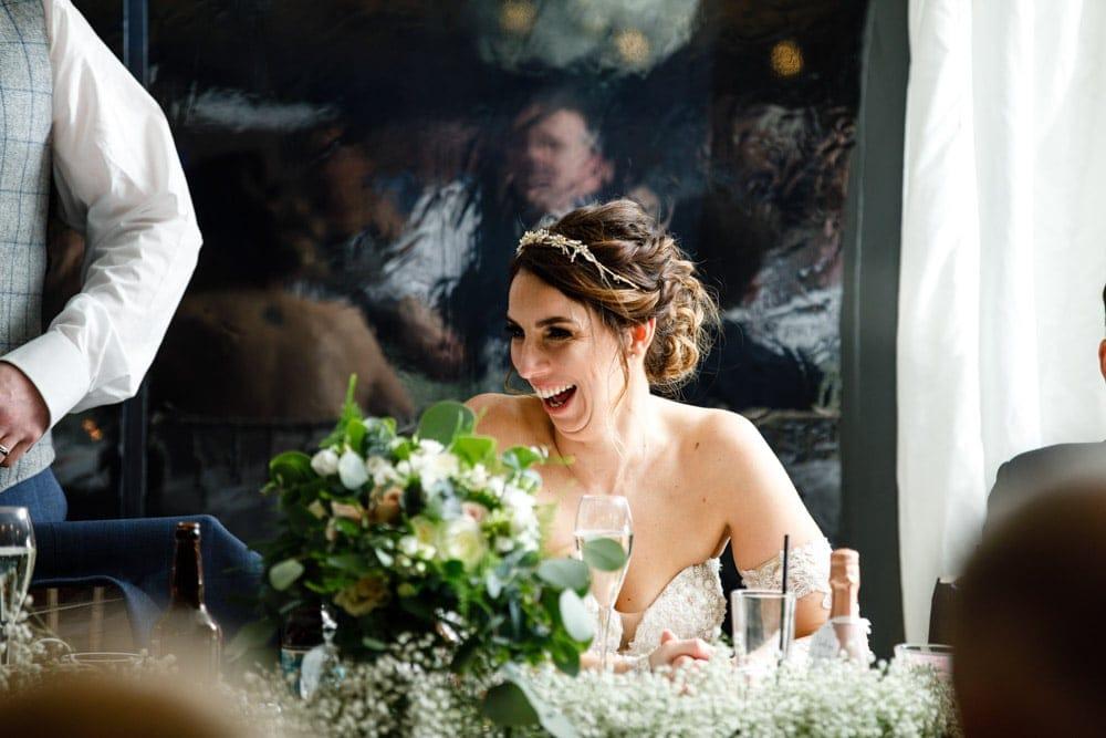 bride laughing at soughton hall