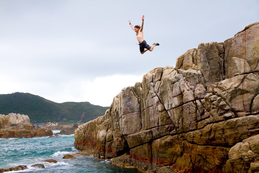 My friend cliff diving at Longdong, one of the best Taiwan summer activities