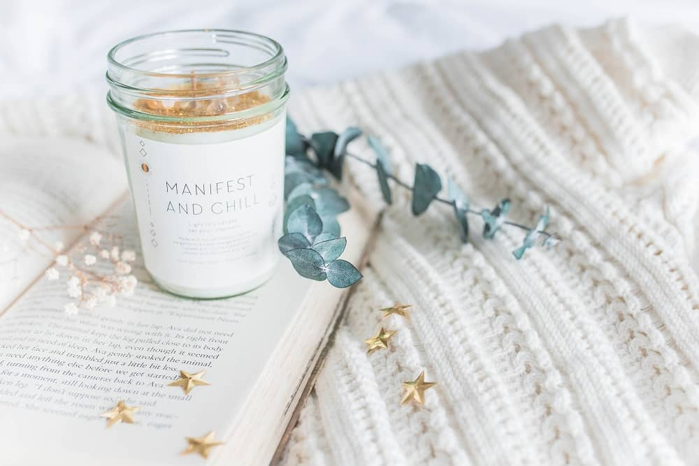 manifest and chill candle and book