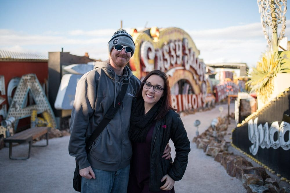 Brooke and Buddy posing near some of the old signs at the Neon Museum - sober things to do in las vegas for non-gamblers