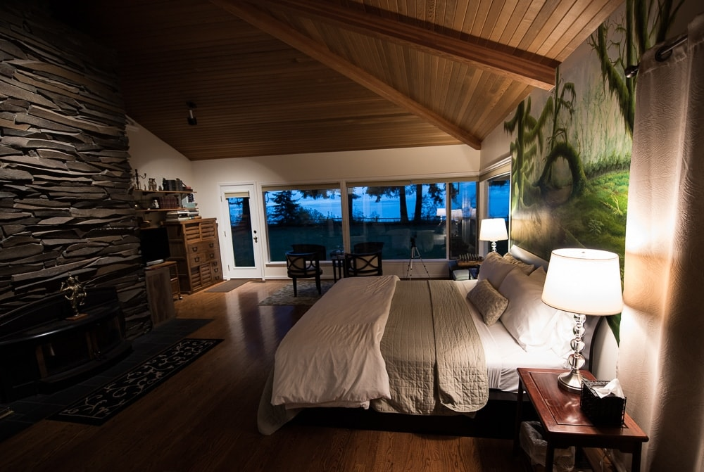 The beautiful Hoh Rainforest Suite at Domaine Madeleine with floor to ceiling windows looking out to the back garden.