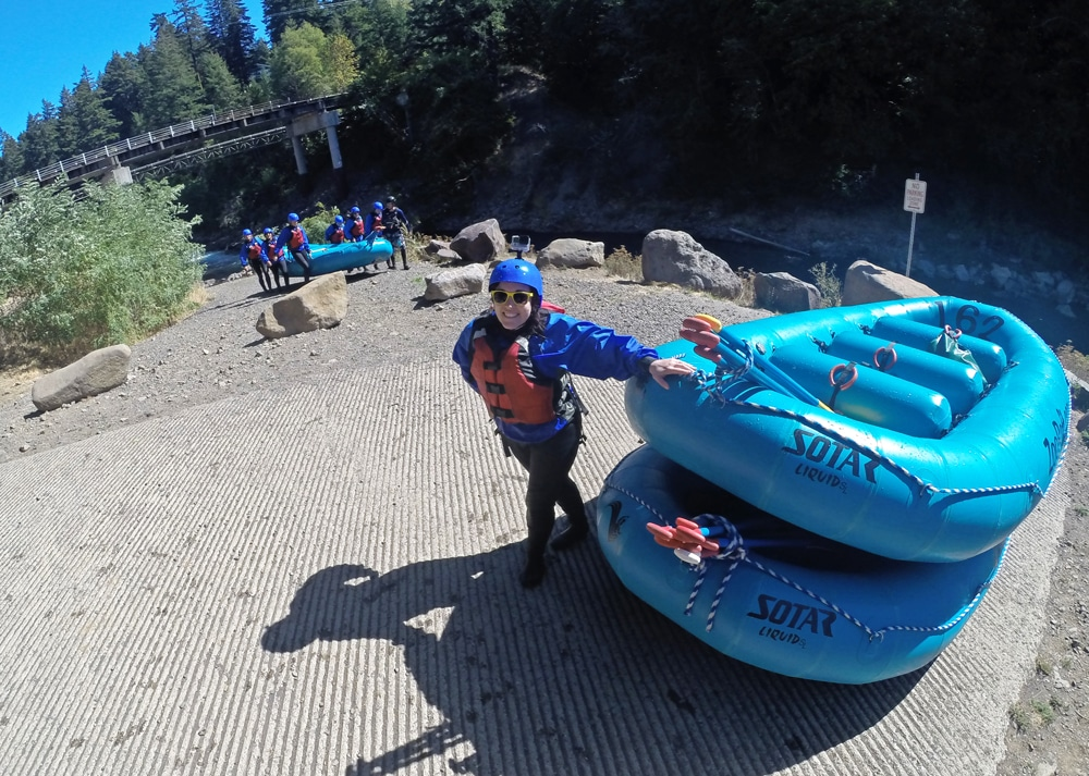 Brooke posing with the rafts after our trip down the white salmon river and over Husam Falls