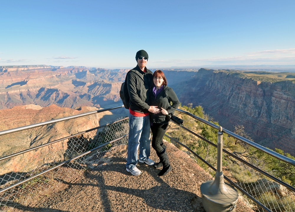 Brooke and Buddy posing for a photo at one of the viewpoints for the Grand Canyon