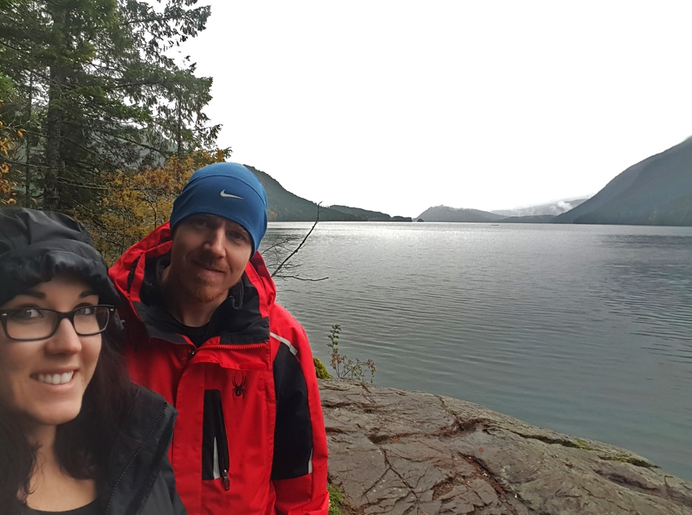 Brooke and Buddy on the shore of a foggy sproat lake