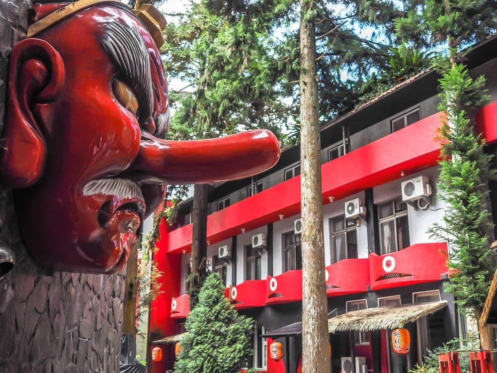 A Tengu monster watches ovetr the Monster Village Hotel