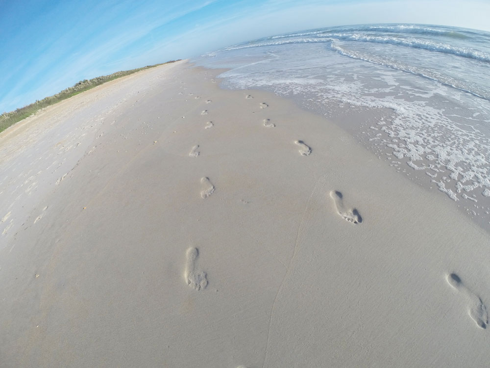 Footsteps in the sand along a beach walk during our St. Augustine weekend getaway