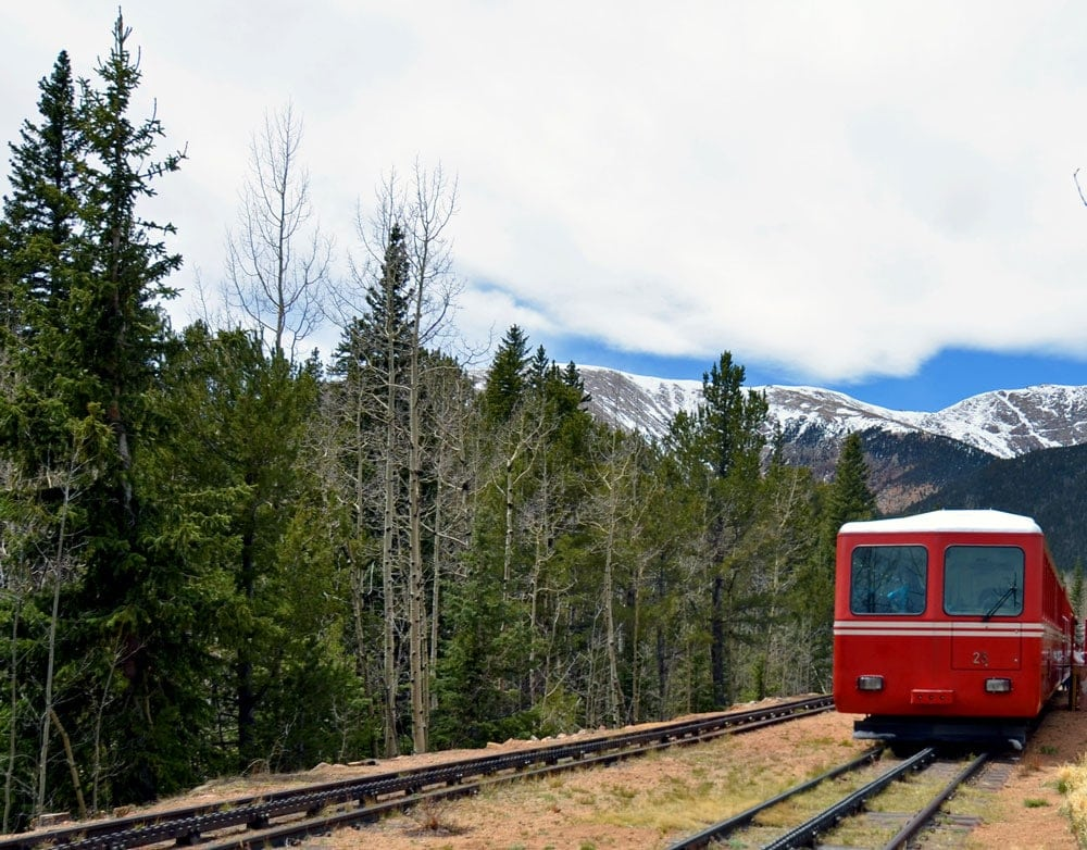 The Pikes Peak Cog Railway at the stopping point surrounded by trees