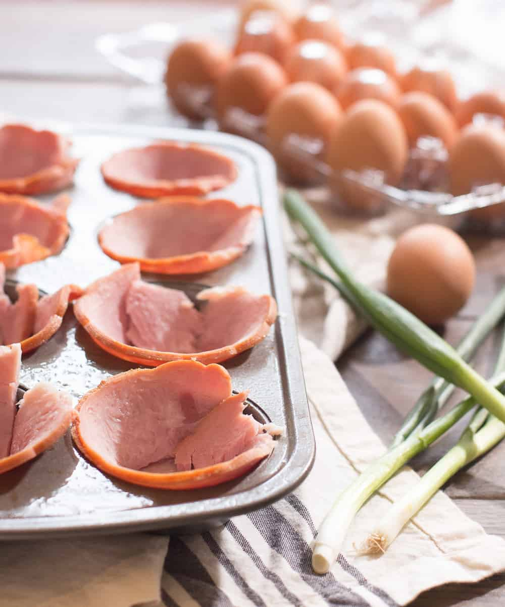 Ham stuffed into muffin tin for ham and egg cups