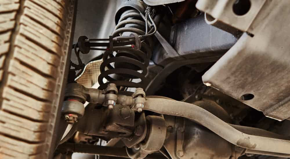 A view from underneath a car is showing what an option for different types of suspension may look like.