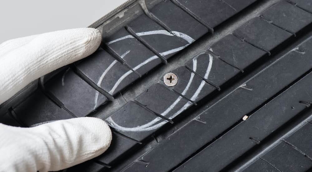 A tire inspection is showing a screw was run over by a tire.
