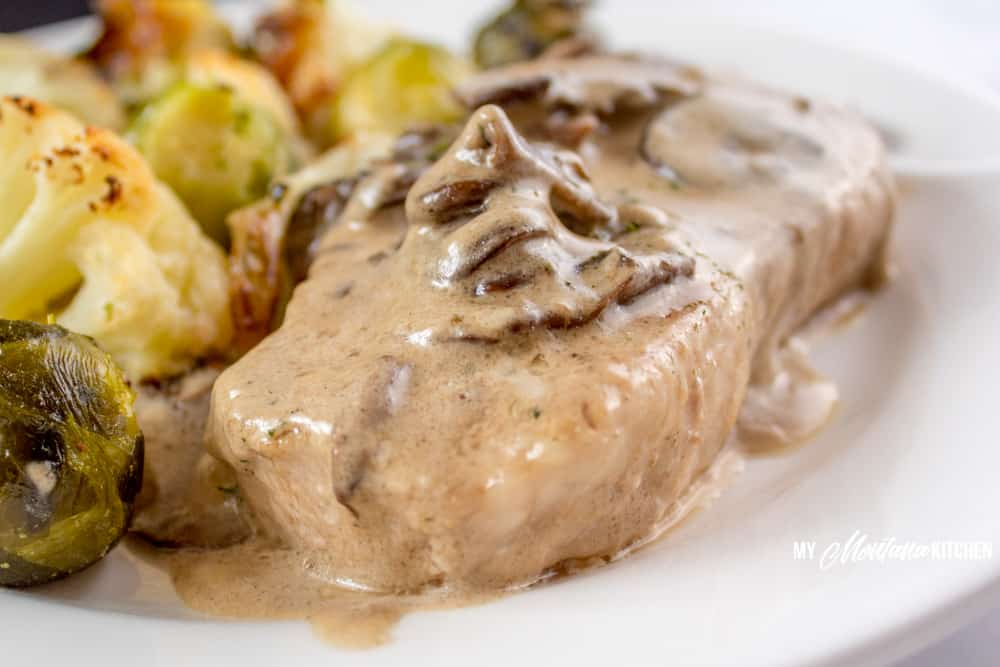 You're going to love this gluten free pork chop gravy on top of your tender meat. This pan fried pork chops recipe has no flour and is low carb, but rich in flavor and sure to please. #lowcarbdinnerrecipe #panfriedporkchops