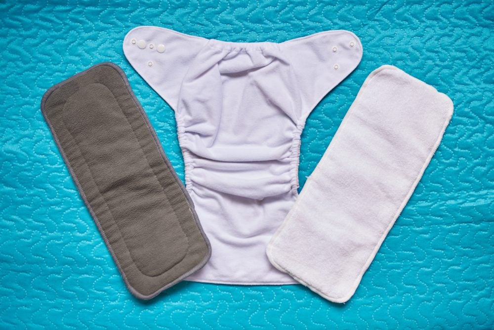 Open cloth diaper with two insert above top view