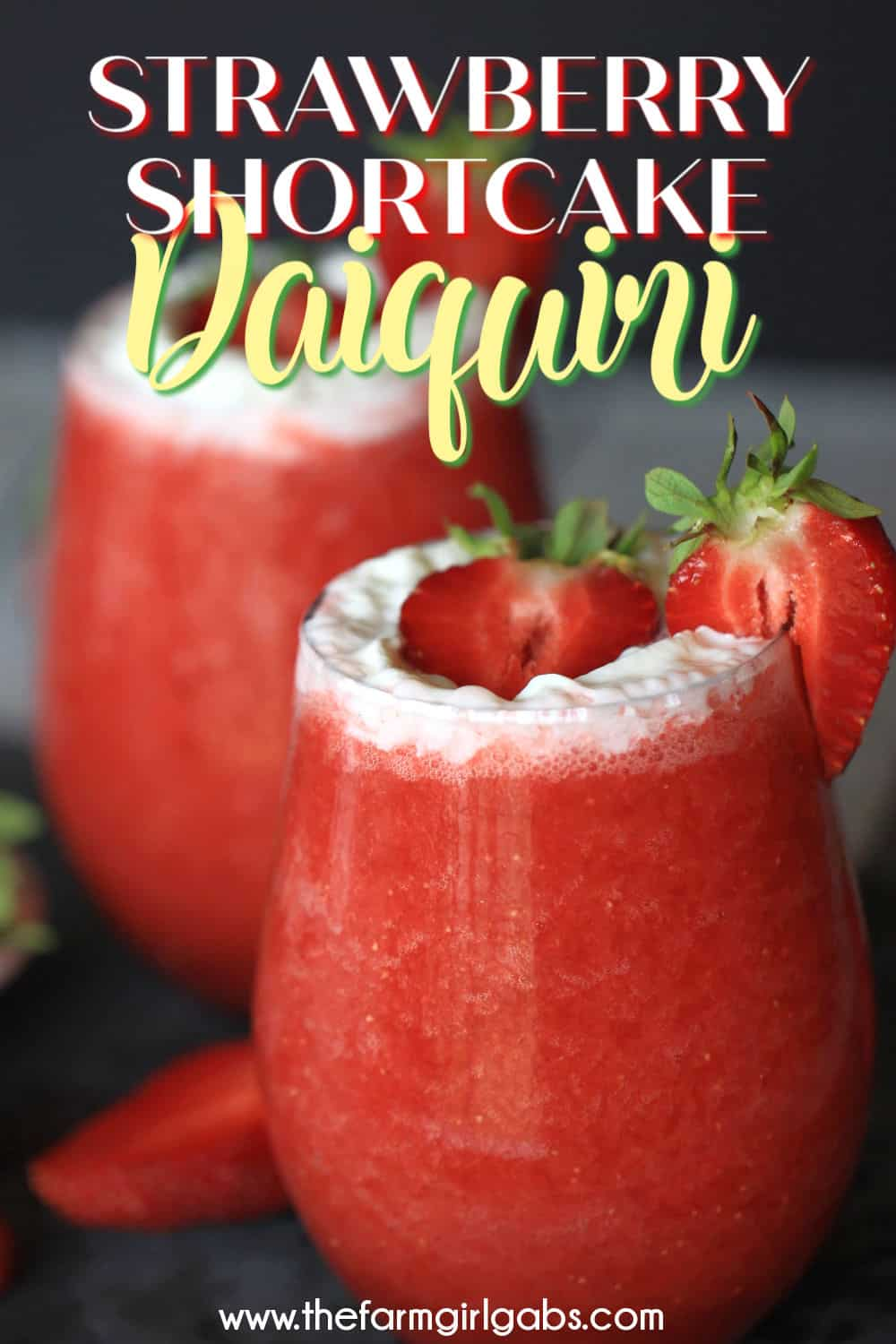 Cheers to Strawberry season. With just a few simple ingredients, you can make your own Strawberry Shortcake Daiquiris at home. Skip the mix and make fresh strawberry daiquiris at home using this easy recipe. It's the perfect slushy cocktail for cooling down in warmer weather! #strawberrydaiquiri #cocktails #slushie