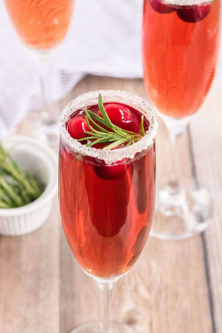 Preparation Tips you can include in your blog post: Brut Champagne is the best bubbly to make mimosa's with. Dry Prosecco or A Cava are also great choices. Whatever you decide, be sure to choose dry since you will be adding juice. Frozen cranberries will work just fine for this recipe. Orange and cranberry go together so nicely, but you can change up the flavor by using lemon or lime on the rim as well.