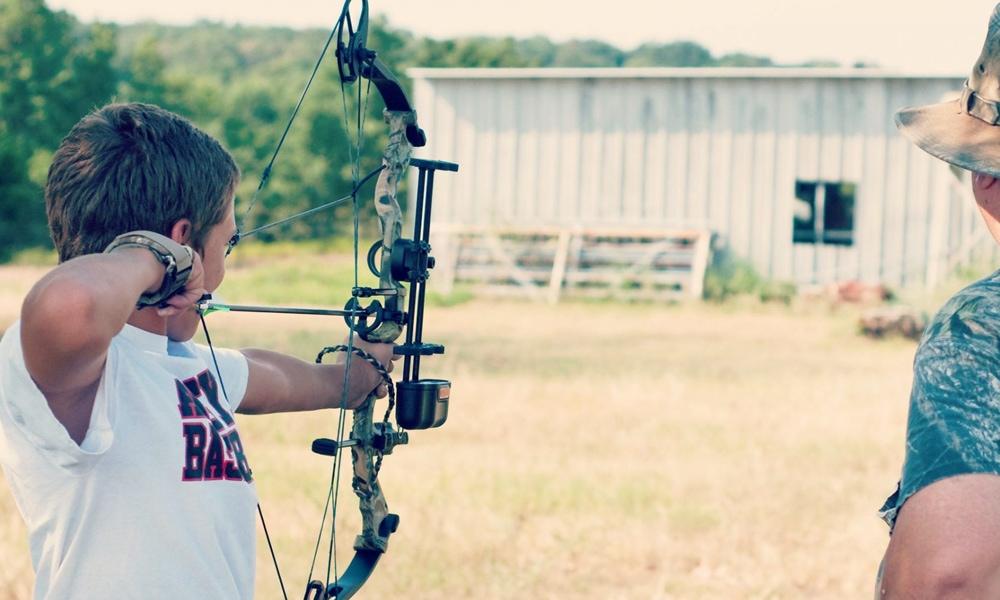 kid shooting bow