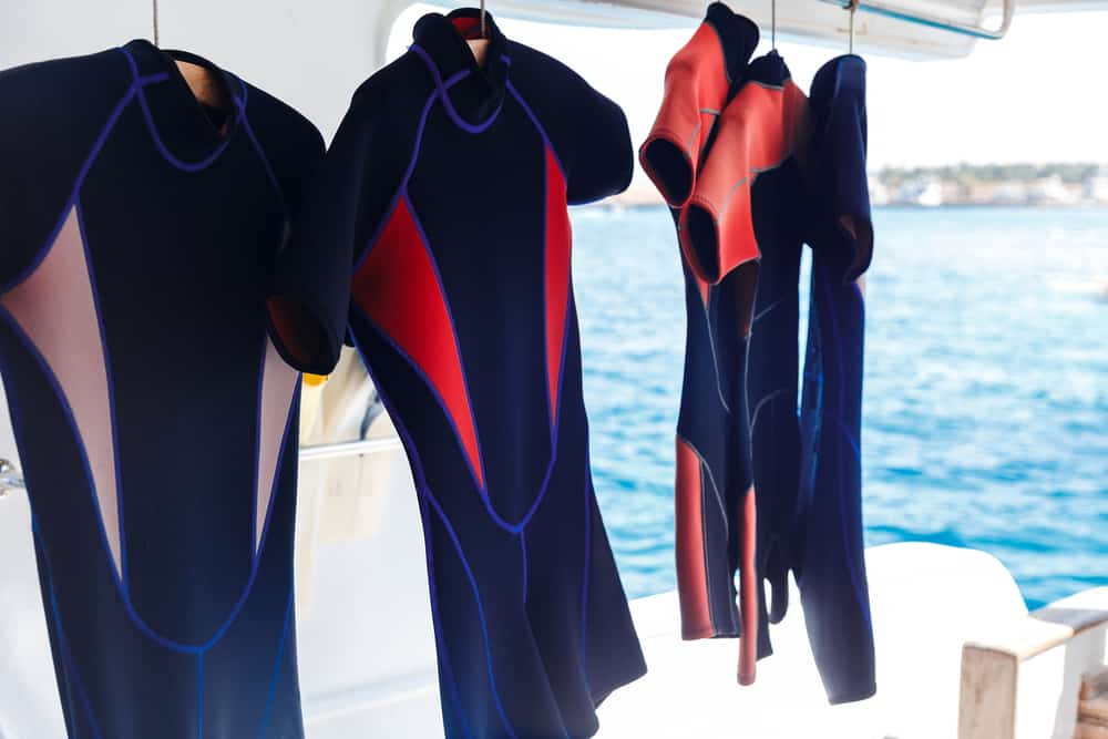 Wetsuits drying after a scuba dive