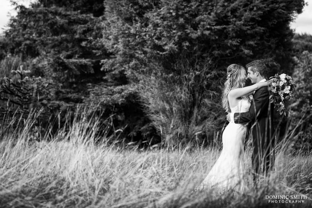 Couple photo taken in the meadow at Nymans